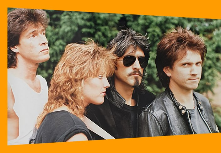 Katrina and The Waves band photo outdoors with orange detailing